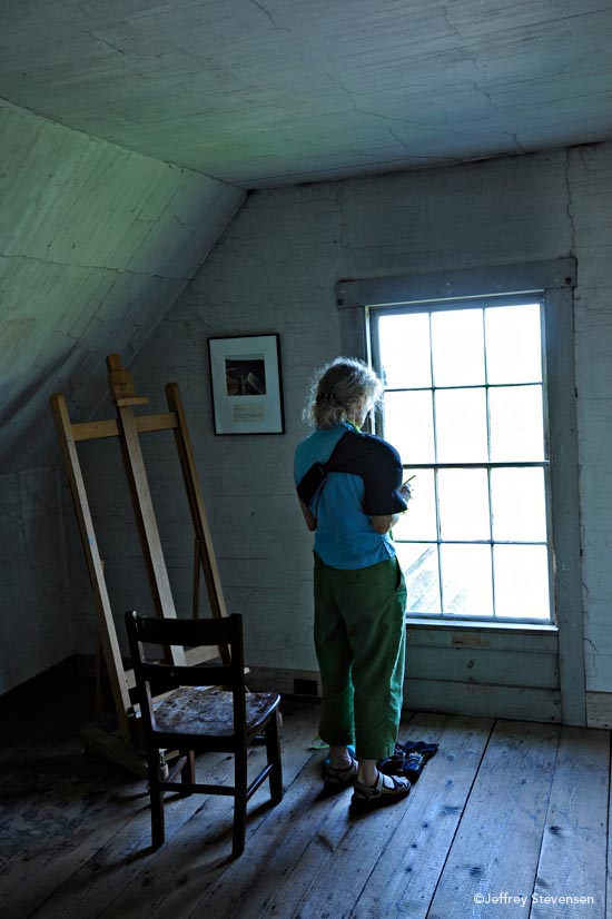 Dana Trattner sketching in the third floor bedroom of Olson House, Cushing, Maine