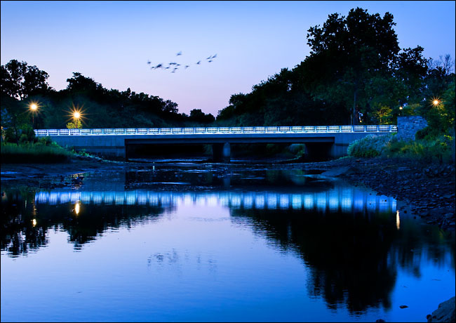 The lighted Richmond Hill Avenue bridge over the Mill River, Stamford, Connecticut. Royal Bank of Scotland is in the background.